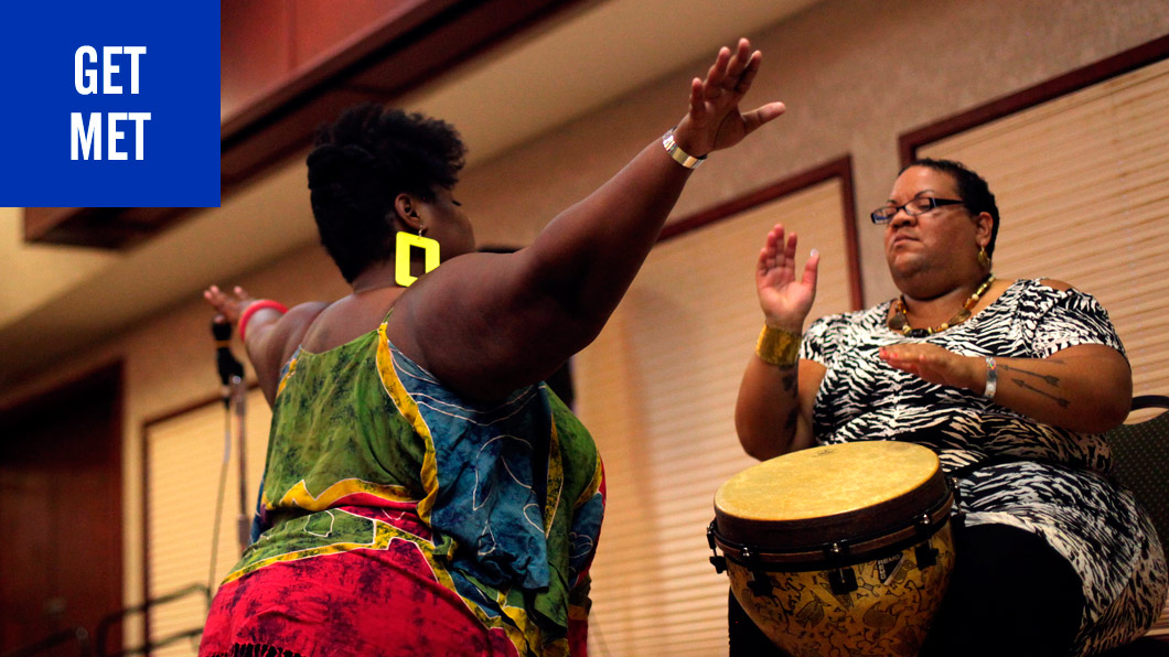 GET MET. Photo of dancer and drummer in African Spiritual Invocation from NOLOSE 2013 conference.